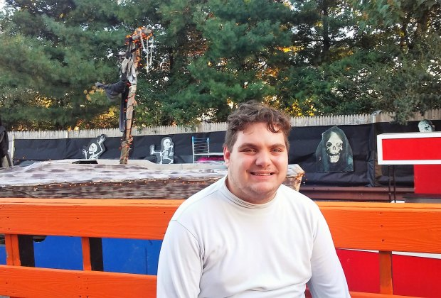Man poses with Stew Leonard's Halloween display in Yonkers