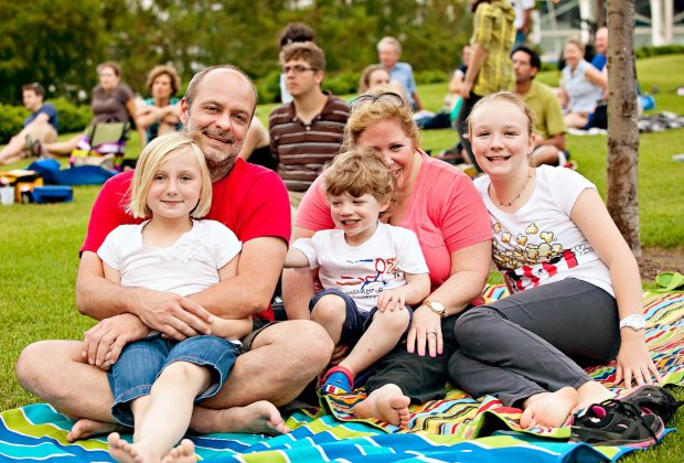 Families enjoy time outside together in the park at Discovery Green. Photo courtesy of Discovery Green.