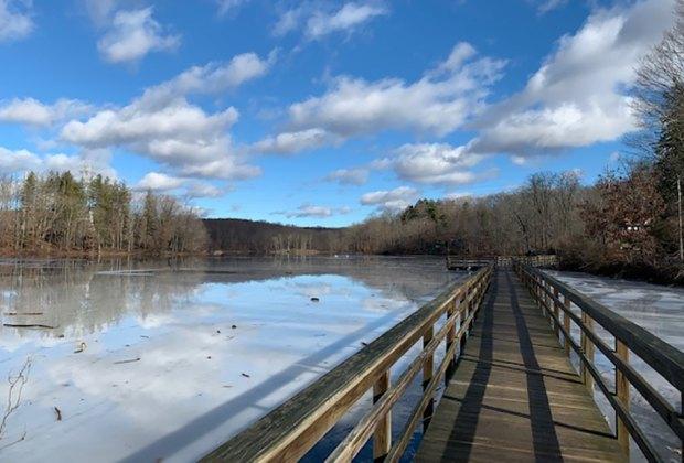 Traverse the bridge across Teatown Lake during your hike.