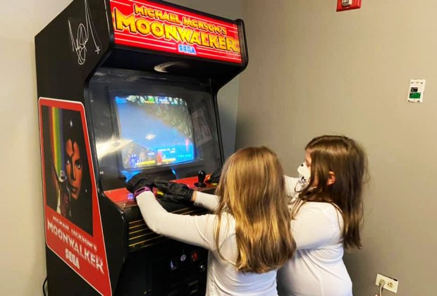 Girls play arcade games at the Cradle of Aviation Museum What's open Now Long Island