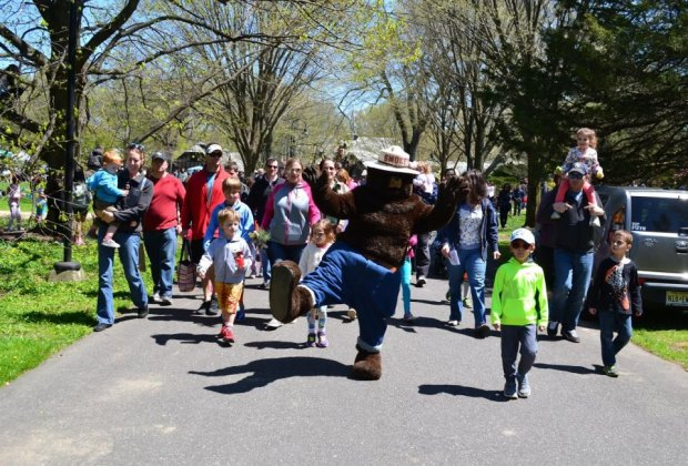 Smokey the Bear leads Planting Fields Arboretum's annual Arbor Day Festival. Photo courtesy of the arboretum