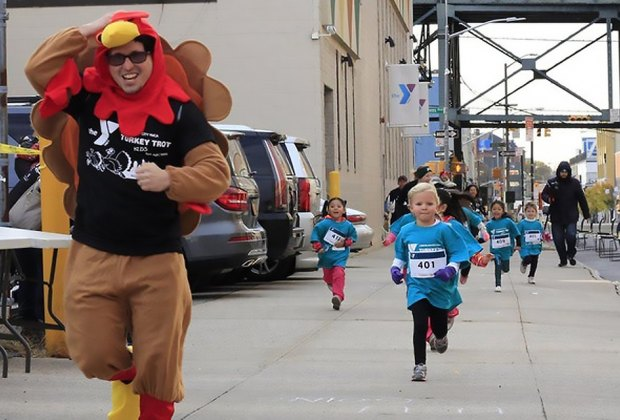 Kick off Thanksgiving morning at the annual Long Island City YMCA Turkey Trot . Photo courtesy of the YMCA