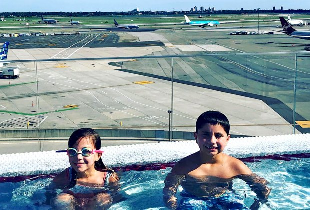 Two kids in the pool at the TWA Hotel