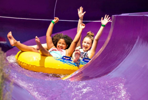 Team up for a tandem slide at Water Wizz.