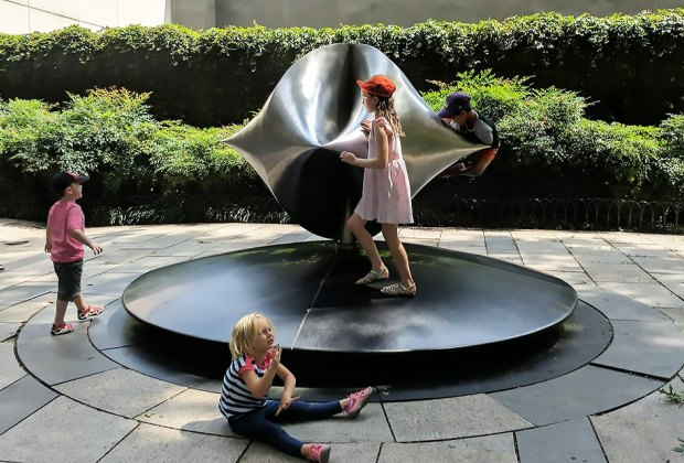 Pondering art and gravity at the Rose Center for Earth and Space. Photo by Winston Johnson